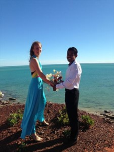 Vithana and Liz as they throw their franjipanis off the ledge at Gantheaume Point after their Wedding Ceremony